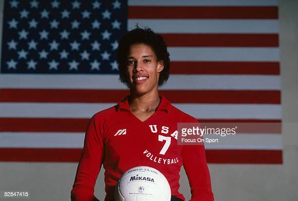 Indoor Voleyball player Flora Hymen poses for a photo in fron of an American flag while holding a volleball Flora Hymen was a pioneer in women's...