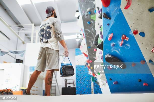 indoor wall climbing and bouldering extreme sports - chalk bag stock pictures, royalty-free photos & images