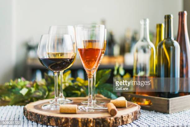 indoor wine tasting with various bottles of wine and glasses - wine cork stock photos and pictures
