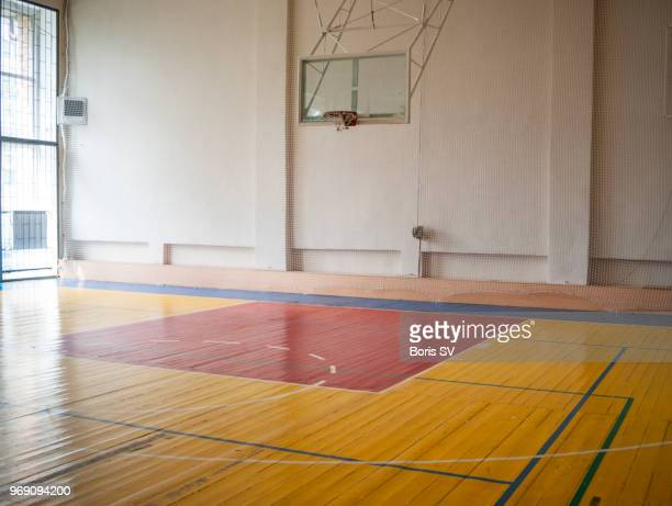 indoors basketball court filled with natural light - empty arena stock pictures, royalty-free photos & images