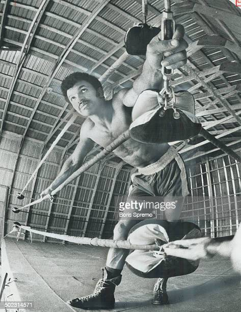 Indoors in ring which he has set up in barn in Claremont farm Clyde Gray rests during training for June 28 world welterweight title fight against...