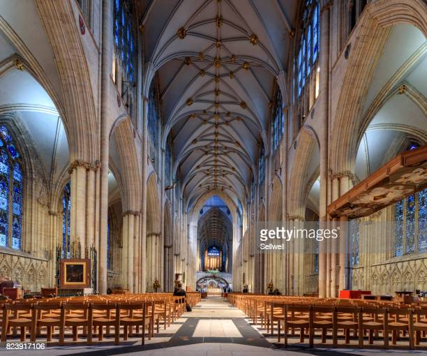 indoors of york minster - york minster stock photos and pictures