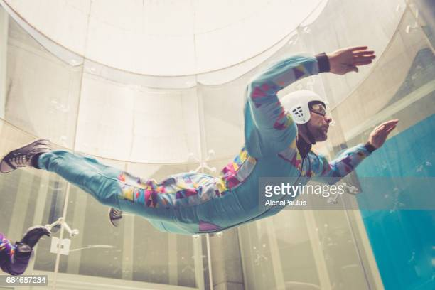 Indoors skydiving - flying - extreme sports point of view - freefall simulation