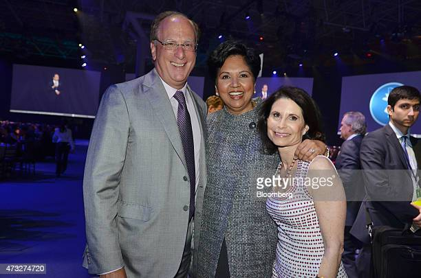 Indra Nooyi chief executive officer of PepsiCo Inc center Laurence Larry Fink chief executive officer of BlackRock Inc left and Lori Fink stand for a...