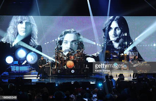 Inductee Alex Lifeson Neil Peart and Geddy Lee of Rush perform on stage at the 28th Annual Rock and Roll Hall of Fame Induction Ceremony at Nokia...