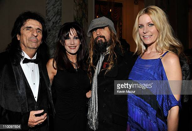 Inductee Alice Cooper Sheryl Cooper and Rob Zombie attends a dinner for the 26th annual Rock and Roll Hall of Fame Induction Ceremony at The...