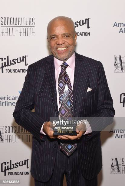 Inductee Berry Gordy poses with award backstage at the Songwriters Hall Of Fame 48th Annual Induction and Awards at New York Marriott Marquis Hotel...