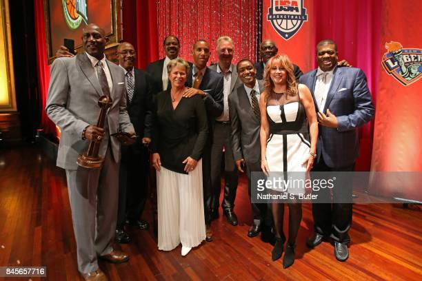 Inductee George McGinnins poses for a photo with Artis Gilmore Reggie Miller Larry Bird Isiah Thomas Ann Meyers Nancy Lieberman and Bob McAdoo on...