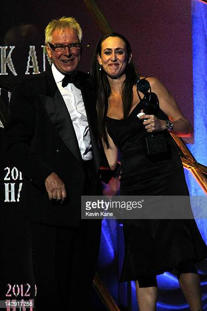 Inductee Glyn Johns and Dana Dowd, whom accepted an award on behalf of her father Tom Dowd speak on stage during the 27th Annual Rock And Roll Hall...