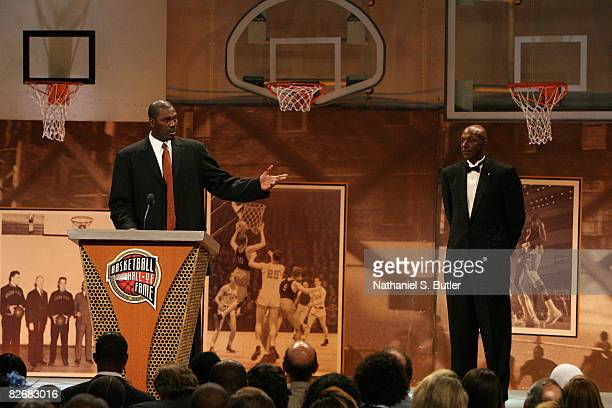 Inductee Hakeem Olajuwon speaks with Clyde Drexler during the 2008 Hall of Fame Enshrinement Ceremony on September 5 2008 at the Basketball Hall of...