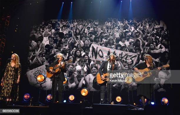 Inductee Joan Baez performs with Mary Chapin Carpenter and Amy Ray and Emily Saliers of Indigo Girls perform onstage during the 32nd Annual Rock Roll...