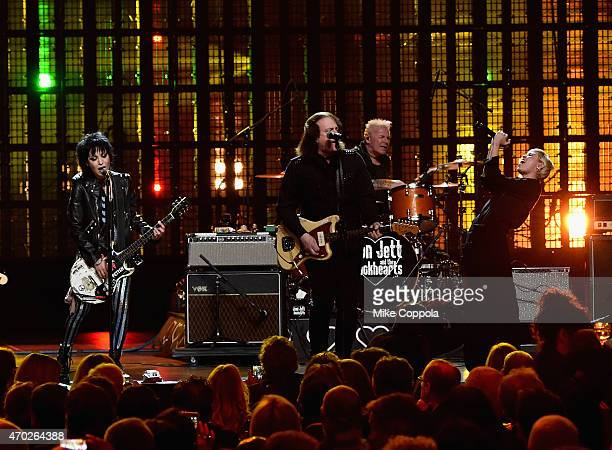 Inductee Joan Jett of Joan Jett and The Black Hearts performs with musicians Tommy James and Miley Cyrus during the 30th Annual Rock And Roll Hall Of...