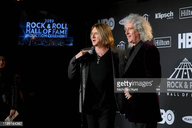 Inductee Joe Elliot of Def Leppard and Queen's Brian May attend the 2019 Rock Roll Hall Of Fame Induction Ceremony Press Room at Barclays Center on...