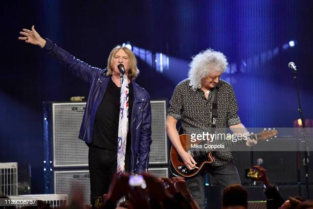Inductee Joe Elliott of Def Leppard and Queen's Brian May perform onstage at the 2019 Rock Roll Hall Of Fame Induction Ceremony Show at Barclays...