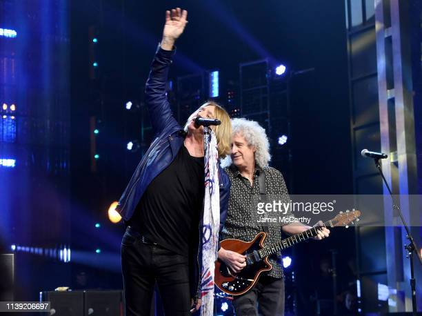 Inductee Joe Elliott of Def Leppard performs with Queen's Brian May at the 2019 Rock Roll Hall Of Fame Induction Ceremony Show at Barclays Center on...