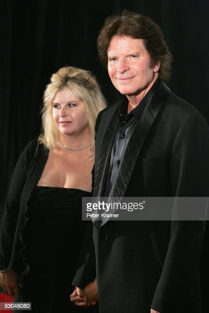 Inductee John Fogerty and his wife Julie Fogerty arrive at the 2005 Songwriters Hall Of Fame induction ceremony at the Marriott Marquis Hotel June 09...