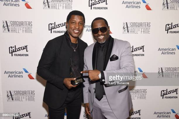Inductee Kenneth 'Babyface' Edmonds and Johnny Gil pose backstage at the Songwriters Hall Of Fame 48th Annual Induction and Awards at New York...
