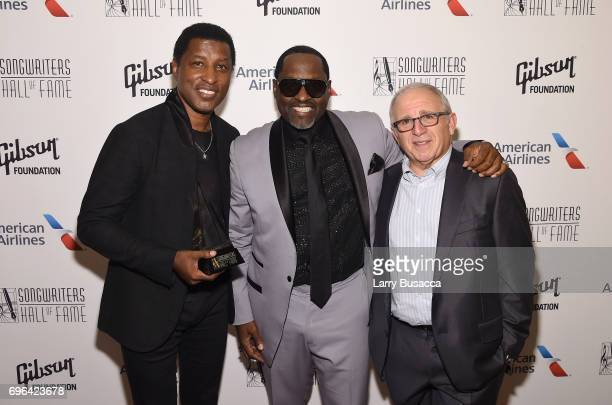 Inductee Kenneth 'Babyface' Edmonds Johnny Gil and Irving Azoff pose backstage at the Songwriters Hall Of Fame 48th Annual Induction and Awards at...