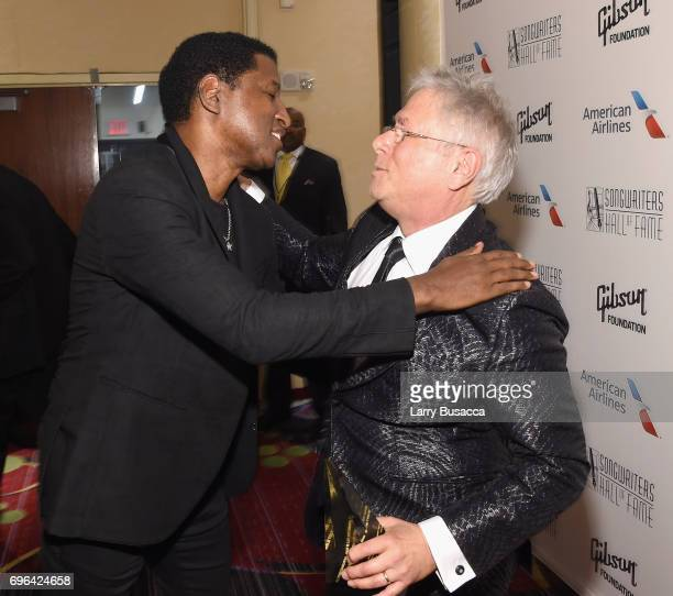 Inductee Kenneth 'Babyface' Emonds and Johnny Mercer Award Winner Alan Menken pose backstage at the Songwriters Hall Of Fame 48th Annual Induction...
