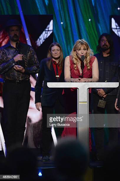 Inductee Krist Novoselic Kimberly Cobain Courtney Love and inductee Dave Grohl speak onstage at the 29th Annual Rock And Roll Hall Of Fame Induction...