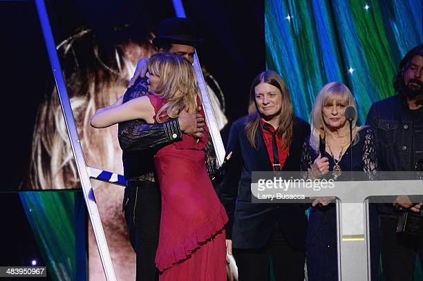 Inductee Krist Novoselic of Nirvana and Courtney Love speak onstage at the 29th Annual Rock And Roll Hall Of Fame Induction Ceremony at Barclays...
