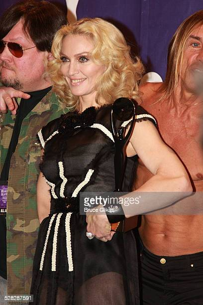 Inductee Madonna poses with Ron Asheton and Iggy Pop of The Stooges in the press room at the 2008 Rock and Roll Hall of Fame Induction Ceremony at...