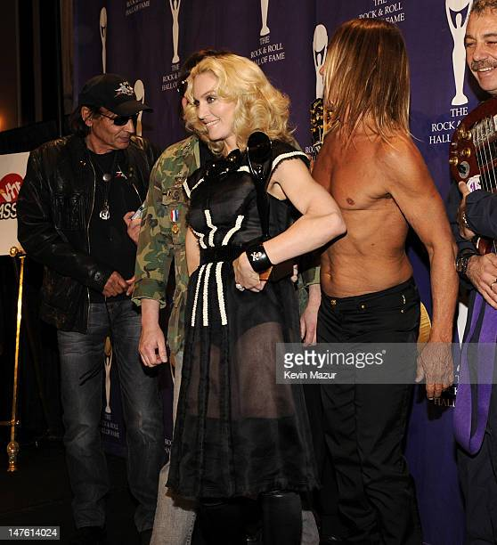 Inductee Madonna poses with Scott Asheton and Iggy Pop of The Stooges in the press room at the 23rd Annual Rock and Roll Hall of Fame Induction...