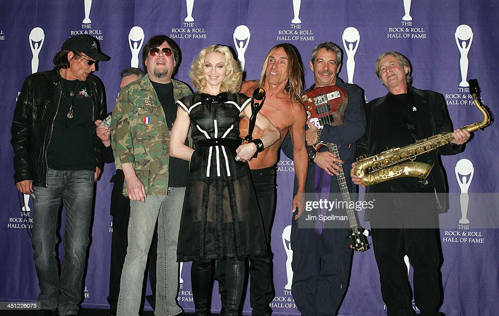 Inductee Madonna (C) poses with Scott Asheton, Ron Asheton, Iggy Pop, Mike Watt and Steve MacKay of The Stooges in the press room during the 23rd Annual Rock and Roll Hall of Fame Induction Ceremony at the Waldorf Astoria on March 10, 2008 in New York City.