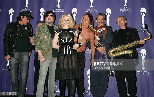Inductee Madonna poses with Scott Asheton Ron Asheton Iggy Pop Mike Watt and Steve MacKay of The Stooges in the press room during the 23rd Annual...