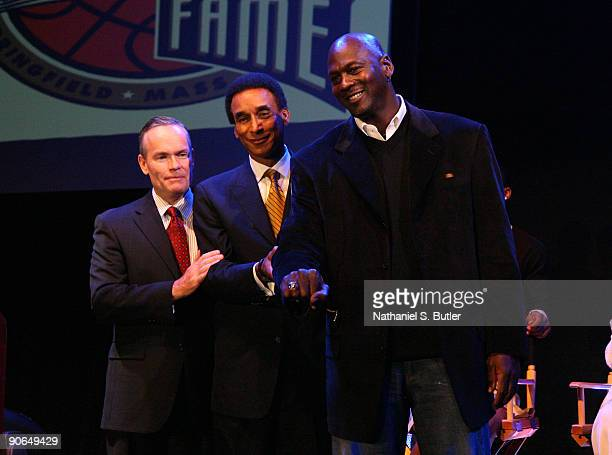 Inductee Michael Jordan receives a ring commemorating his entrance to the Basketball Hall of Fame Class of 2009 from Hall of Fame Chairman of the...