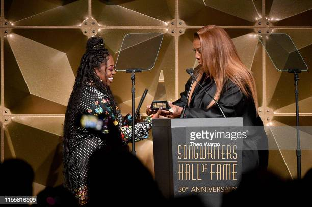 Inductee Missy Elliott and Queen Latifah embrace onstage during the Songwriters Hall Of Fame 50th Annual Induction And Awards Dinner at The New York...
