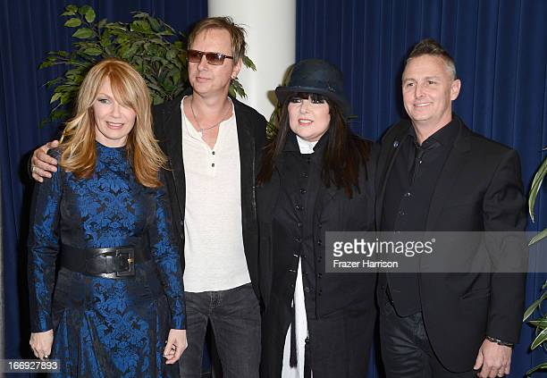 Inductee Nancy Wilson of Heart musician Jerry Cantrell of Alice in Chains inductee Ann Wilson of Heart and musician Mike McCready of Pearl Jam attend...