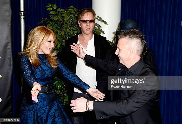 Inductee Nancy Wilson of Heart with musicians Jerry Cantrell of Alice in Chains and Mike McCready of Pearl Jam attend the 28th Annual Rock and Roll...