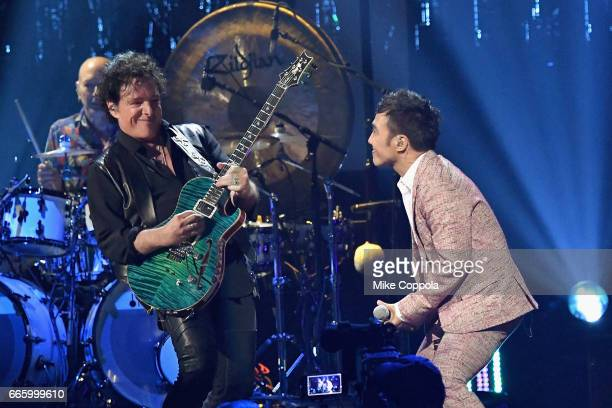 Inductee Neal Schon and musician Arnel Pineda of Journey perform onstage at the 32nd Annual Rock Roll Hall Of Fame Induction Ceremony at Barclays...