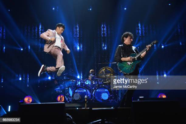 Inductee Neal Schon of Journey and Arnel Pineda performs onstage at the 32nd Annual Rock Roll Hall Of Fame Induction Ceremony at Barclays Center on...