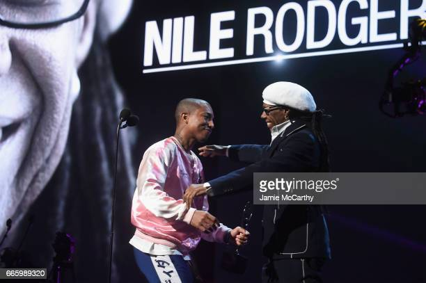 Inductee Niles Rodgers hugs presenter Pharrell Williams onstage at the 32nd Annual Rock Roll Hall Of Fame Induction Ceremony at Barclays Center on...