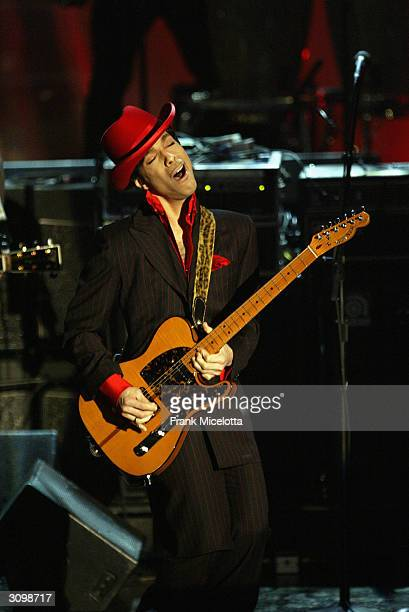 Inductee Prince performs following George Harrison's induction at the Rock Roll Hall Of Fame 19th Annual Induction Dinner at the Waldorf Astoria...