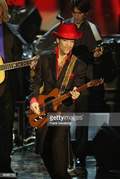 Inductee Prince performs following George Harrison's induction at the Rock & Roll Hall Of Fame 19th Annual Induction Dinner at the Waldorf Astoria...