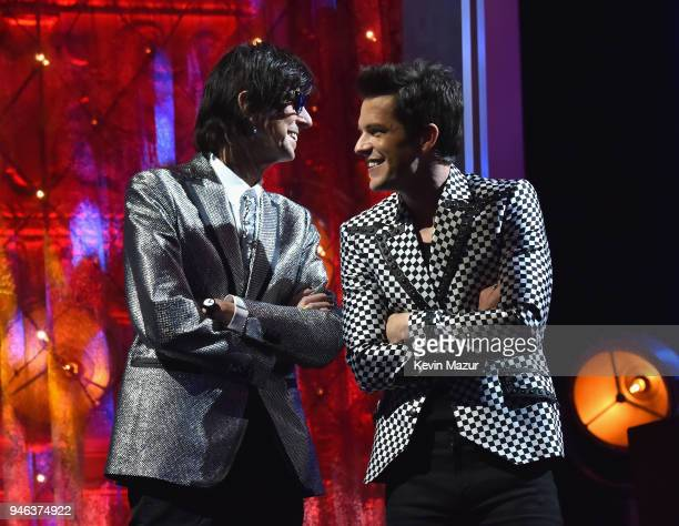 Inductee Ric Ocasek of The Cars and musician Brandon Flowers speak onstage 33rd Annual Rock Roll Hall of Fame Induction Ceremony at Public Auditorium...