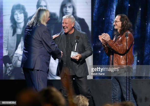 Inductee Rick Wakeman of Yes and presenters Alex Lifeson and Geddy Lee of Rush onstage at the 32nd Annual Rock Roll Hall onstage at the 32nd Annual...