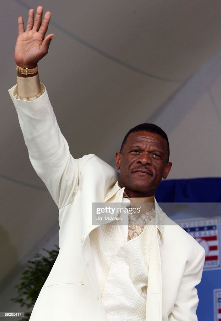 2009 inductee Rickey Henderson waves to the crowd at Clark Sports Center during the Baseball Hall of Fame induction ceremony on July 26, 2009 in Cooperstown, New York. Henderson is the all-time leader in stolen bases (1,406) and runs (2,295), a ten time All-Star, was the 1990 American League most valuable player and won two World Series titles.
