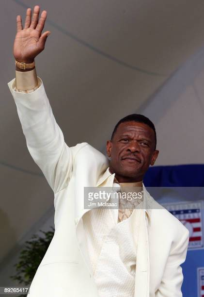 Inductee Rickey Henderson waves to the crowd at Clark Sports Center during the Baseball Hall of Fame induction ceremony on July 26, 2009 in...