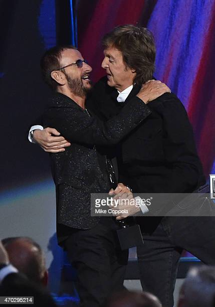Inductee Ring Starr and Sir Paul McCartney speak onstage during the 30th Annual Rock And Roll Hall Of Fame Induction Ceremony at Public Hall on April...