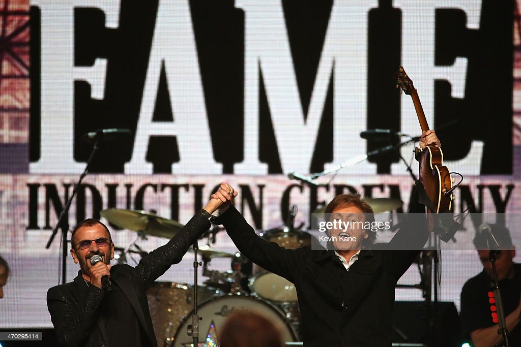 Inductee Ringo Starr and Paul McCartney perform onstage during the 30th Annual Rock And Roll Hall Of Fame Induction Ceremony at Public Hall on April 18, 2015 in Cleveland, Ohio.