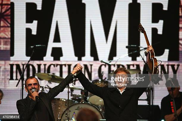 Inductee Ringo Starr and Paul McCartney perform onstage during the 30th Annual Rock And Roll Hall Of Fame Induction Ceremony at Public Hall on April...