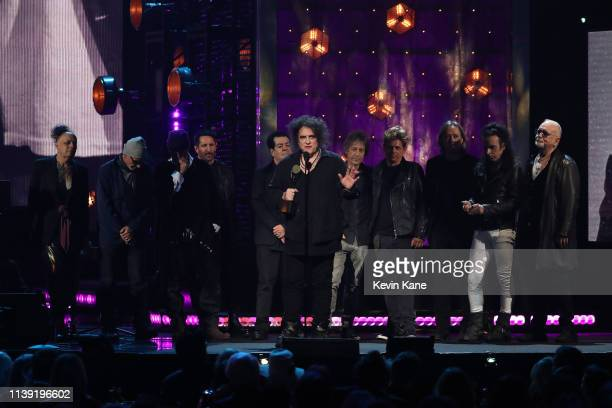 Inductee Robert Smith and members of The Cure speak onstage at the 2019 Rock & Roll Hall Of Fame Induction Ceremony - Show at Barclays Center on...