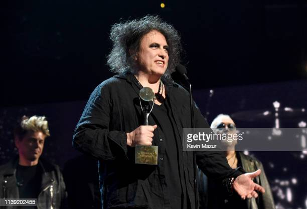 Inductee Robert Smith and members of The Cure speak onstage at the 2019 Rock Roll Hall Of Fame Induction Ceremony Show at Barclays Center on March 29...
