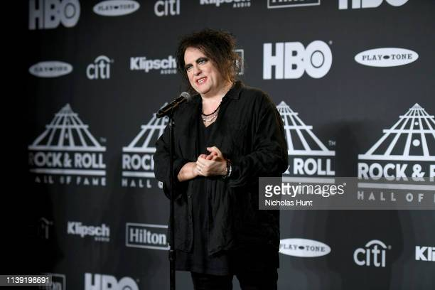 Inductee Robert Smith of The Cure poses in the press room at the 2019 Rock Roll Hall Of Fame Induction Ceremony Press Room at Barclays Center on...