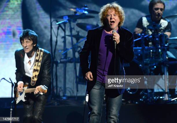 Inductee Ron Wood Mick Hucknall and Kenney Jones perform on stage at the 27th Annual Rock And Roll Hall Of Fame Induction Ceremony at Public Hall on...