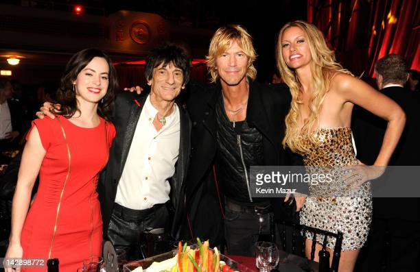 Inductee Ron Wood of Faces, inductee Duff McKagan of Guns N' Roses and Susan Holmes attends the 27th Annual Rock And Roll Hall Of Fame Induction...